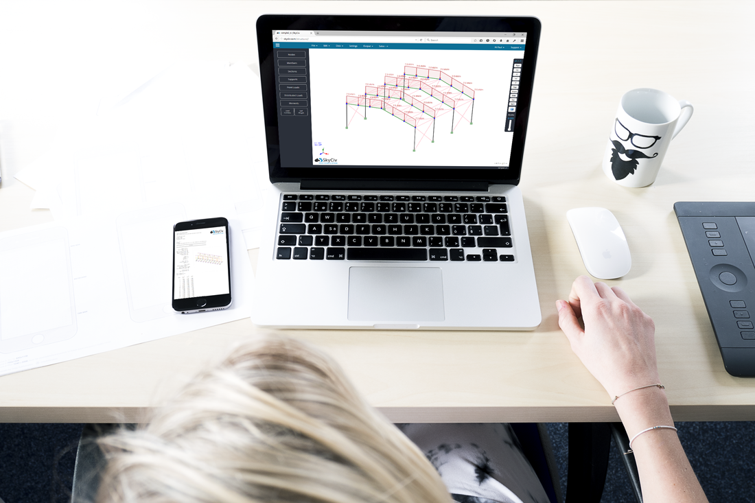 girl working on structural analysis software on her desk